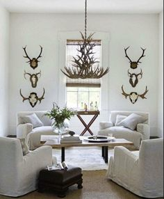 Perfect blend of his and hers style. Love the neutral with the dark antlers and chandelier. Formal dining room?