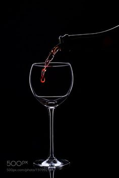 Wine glasses with wine bottle on a black background minimalism by oleghz  IFTTT 500px