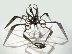This large scissor spider is made entirely from TSA-confiscated goods. The bug is made from parts of TSA-confiscated Swiss army knives.