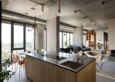 Metal-topped counters were added to this Kiev apartment by Ukrainian designer Olga Akulova.