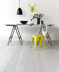 Gorgeous white timber flooring. We have a similar floor in laminate at doorandfloorstore.co.uk/white-chestnut-10mm-x-159mm-laminate-flooring.html Loving the colour-pop here, too!