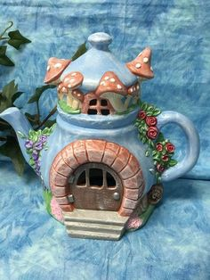 Handcrafted lighted fairy house teapot, handcrafted fairy house, lighted fairy h. Clay Fairy House, Fairy Garden Houses, Gnome House, Polymer Clay Fairy, Polymer Clay Crafts, Bottle Art, Bottle Crafts, Clay Teapots, Clay Houses