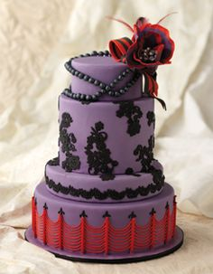 Love this gorgeous purple and red wedding cake!