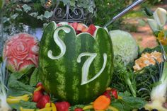 Initials carved in watermelon rind