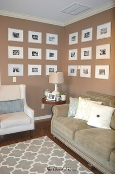 Living room gallery wall with black and white photos by The Cheerful Home.