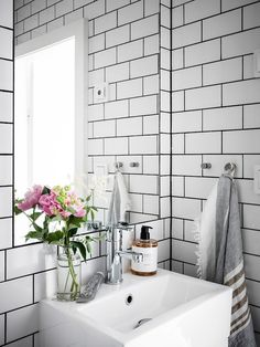 my scandinavian home: A Small Swedish Space That Will Make You Want to Downsize! #bathroom #whitetiles #blackgrouting #smallbathroom