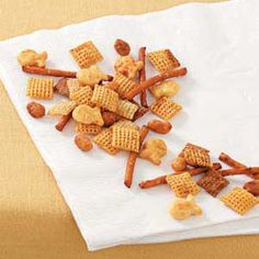 Odds 'n' Ends Snack Mix Recipe -Cayenne pepper packs some punch in this crunchy blend of cereal, crackers, pretzels and peanuts from Terry Kuehn of Waunkee, Wisconsin. Although it makes a big batch, you might have to make more at halftime!