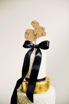Black & Gold NYE Wedding: glittered cake topper by Anna Elizabeth Cakes.