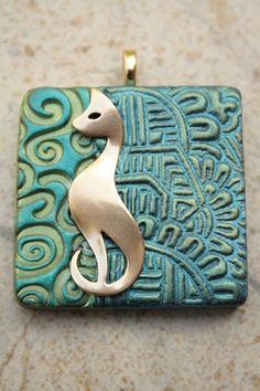 SINGING CAT STUDIO is place were create ( for our scientists) anonymous college professor, buttons lover and aspiring artist form Ph. Polymer Clay Pendant, Fimo Clay, Polymer Clay Projects, Polymer Clay Creations, Polymer Clay Art, Clay Beads, Polymer Clay Jewelry, Cat Jewelry, Ceramic Jewelry