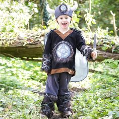A four piece Viking outfit in black grey and brown The tunic is finished with a chest emblem the sleeves have faux fur gauntlets and the trousers