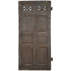 View this item and discover similar for sale at - English oak door from a Lincolnshire estate house originating from the early It has original paint, hinges and handcarved feature panel.