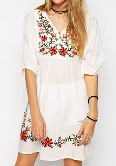 Front view of model in floral embroidered shift dress