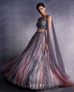 #TheStripesOfFantasy  Embark on this multi-colored-multi-decade-multi-kitsch like sensibilities. Meet the blush redux and grey hued pleated skirt style that lends to a more romantic pallet of colors to accompany the obvious show-offyness of the metallic pleats. Bringing out the pretty metallic stripe trend as the epitome of femininity, this indo-western exclusive really packs a punch.