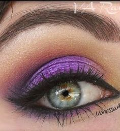 Makeup / green eyes with purple and orange shadow
