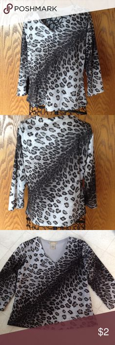 "Apostrophe animal print top with 3/4 sleeves V neck top is lined in front and back. 100% polyester and gently worn. Length is 20"", across front is 17 1/2"". Apostrophe Tops"