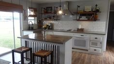 complete kitchen renovation on a tiny budget = I like the island metal and the concrete sink