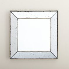 Ennis Mirror | This mirror's hefty frame is finished with the look of antiqued mercury glass for additional shine.