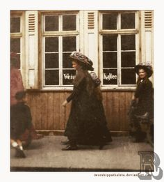 A very rare moment . The sisters had traveled to England with their parents and were allowed to go shopping one after noon. This was taken while they were out and about. Grand Duchesses Olga, Anastasia, and Maria.
