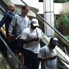 Peyton Manning Has Protection On The Escalator