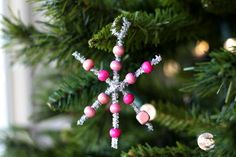 Make a beaded snowflake ornament to decorate for the holidays.