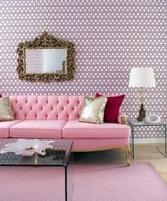 living rooms - pink chesterfield sofa gilt mirror lucite acrylic coffee end tables gold pillows red velvet pillow pink wallpaper  Venetian mirror,