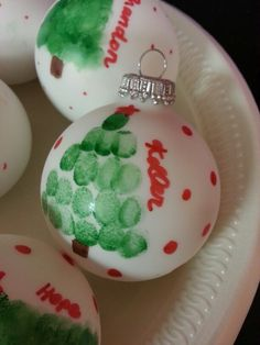 Ink stamp fingerprints on a Christmas ball #christmas #craft #toddlers #kids