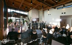 Indoor Wedding Ceremony. Amanda and Tony's wedding. By: H Photography