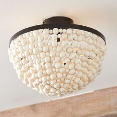 Our Yasmin Ceiling Mount is handmade from hundreds of soft white wood beads that alternate in size for layer upon layer of natural texture. Beads are hand strung over wire and mounted on a metal frame. Ceiling Light Fixtures, Ceiling Lights, Flush Mount Lighting, Foyer Lighting, Bedroom Lighting, Lighting Ideas, Japanese Home Decor, I Love Lamp, 3 Light Chandelier