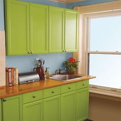 Brighten up dark, dreary cabinets with a fresh coat of cheerful paint for an easy update at a small cost.
