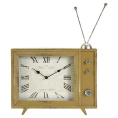 Featuring a retro TV-inspired design and Roman numeral face, this metal, wood, and glass table clock brings charming appeal to your living room or den.