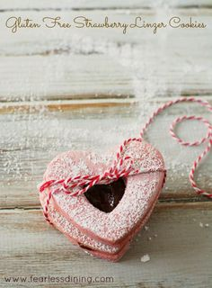 Fun heart shaped gluten free strawberry linzer cookies are perfect for Valentine's Day.Easy to make, fill them with jam, frosting, or Nutella.