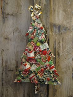 Mosaic Christmas tree featuring vintage carolers, mosaic art.
