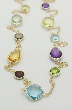 http://www.ebay.com/itm/14K-Yellow-Gold-Fancy-Cut-Gemstone-Necklace-36-New-/130519044946?pt=US_Fine_Necklaces_Pendants=item1e638a9352