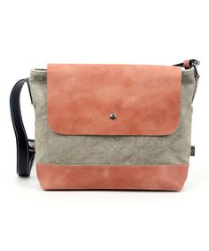 Whether it's carrying your books or other accessories, this messenger bag ensures that your essential stay organized while you're about town. Supple leather and soft cotton lend a sophisticated and modern touch to your look.