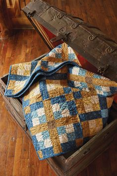 There's nothing like a warm flannel throw quilt for relaxing after a long winter day. Brown and blue flannel prints in Cozy Comfort, by Sarah J. Mazwell, make this a great masculine quilt!