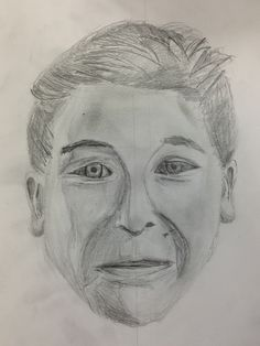 Matthew, analytical self portrait showing understanding for proportion and tonal shading. St Mary's Catholic High School