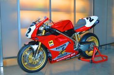 1996 Ducati SBK of Troy Corser at Dainese's Showroom, http://www.daidegasforum.com/forum/dainese-agv/600278-daidegas-dainese-agv-report-visita.html