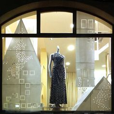 Using paper to create winter window display.  Naked City Landscape by Natascha Madeiski and Alexander Graef