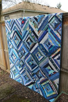 This quilt will certainly brighten up a room on a dark winter day! This pretty blue string quilt is not only lovely to look at but it is foundation pieced for durability and added warmth. This is such a special quilt for the one in your life that can't get enough blue! Every decadent shade is found in this quilt.