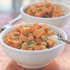 Chickpea and Sweet Potato Curry Recipe Main Dishes with canola oil, yellow onion, garlic cloves, fresh ginger, chili, curry powder, freshly ground pepper, sweet potatoes, garbanzo, coconut milk, water, frozen peas, diced tomatoes, basmati rice