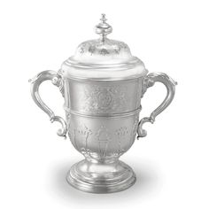 A massive Royal George II silver two-handled cup and cover, Thomas Farren, London, 1741 in earlier style with molded border, cut-card strapwork, and leaf-capped handles, finely engraved on one side with the Royal Arms and supporters, on the other side engraved possibly later with the Royal badge, repeated on the cove