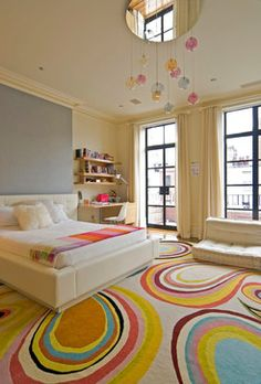 Fun Tween or Teenagers Bedroom. Love the colorful rug and mirror above the ceiling light.