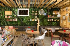 Completed in 2015 in Medellín, Colombia. Images by Daniel Mejía. 9 ¾ is a bookstore cafe specialized in children, but where adults can also have some fun. We believe that cities need warm and nice meeting places. Book Cafe, Design Café, Design Blog, Cafe Interior Design, Cafe Design, Bookstore Design, Cafe Bookstore, Cafe Pictures, Kids Cafe