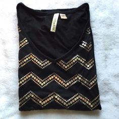 Eyeshadow Black and Gold Chevron Vneck worn a few times- in good condition with some pilling but nothing too bad. it is cap sleeves eyeshadow Tops Tees - Short Sleeve