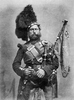 Piper David Muir, 42nd Royal Highland Regiment. Aldershot, 1856. ('Crimean heroes' Cundall & Howlett)  42nd tartan doublet ?and kilt. Royal Stewart plaid.