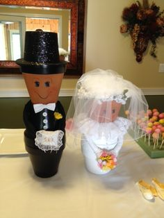 Bride and groom made from painted clay flower pots.  it was the hit of the party.