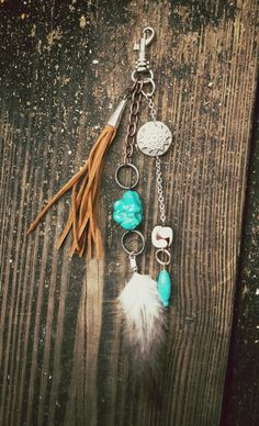 hunteress- keychain or zipper pull- feather, stone, silver Aztec coin, bone, leather fringe by Sailor's Omen. $32.00, via Etsy.