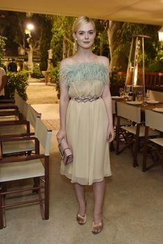 In a Old Hollywood-esque Miu Miu Cocktail Dress  - ELLE.com