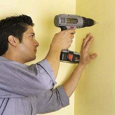 checking for wall studs before installing wall mounted shelves