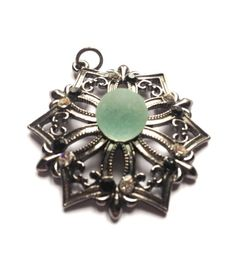 Vintage antique silver look pendant with crystals and lost centre crystal replaced with a sea glass marble by Cyclopaedia, £8.00